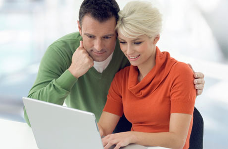 couple-looking-at-a-laptop2_460x300
