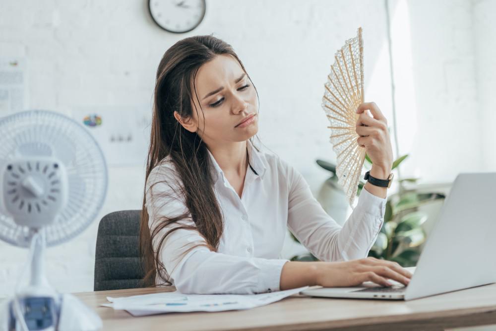 business woman holding fan